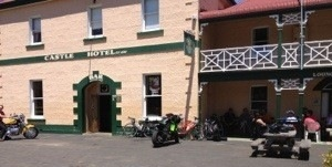 Castle Hotel with friends who rode or drove up to Bothwell to see us off. Some of them had much faster bikes than us and attracted the attention of a local photographer.