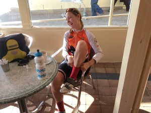 Bec with her red wooden socks and road cycling shoes - quality cycle touring gear